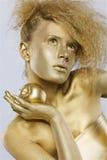 guld- äppleflicka Royaltyfria Bilder