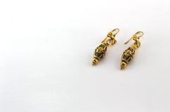Guld- örhängen Royaltyfria Bilder