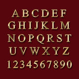Guld- alfabet med nummer stock illustrationer
