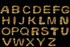 Guld- alfabetuppsättning Arkivfoton