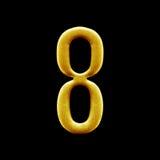 Guld- arabiska för nummer som åtta isoleras på svart bakgrund Fotografering för Bildbyråer