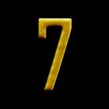 Guld- arabiska för nummer som sju isoleras på svart bakgrund Royaltyfria Bilder