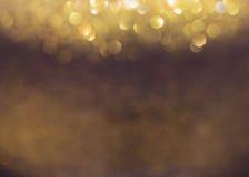 Guld- bakgrund, abstrakt guld- bokehljusberöm Arkivfoton