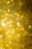 Guld- bakgrund, abstrakt guld- bokehljusberöm Fotografering för Bildbyråer