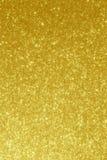 Guld- bakgrund - abstrakta suddighetsmaterielfoto Royaltyfri Fotografi