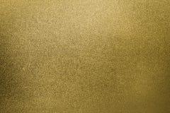 Guld- bakgrund blänker abstrakt begrepp p för folie för texturgnistrandelutningen royaltyfri fotografi