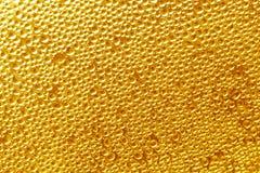 Guld- bakgrund - droppmaterielfoto Arkivfoto