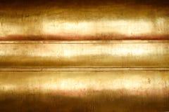 Guld- bakgrund för abstrakt begrepp för metallBuddhastaty Royaltyfri Foto