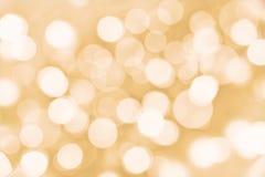 Guld- bakgrund för ferie med blurredlights Arkivbild