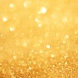 Guld- bakgrund för julljus med mousserande bokeh Abstrac Royaltyfri Fotografi