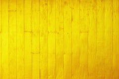 Guld- bakgrund för målarfärgträvägg royaltyfri bild