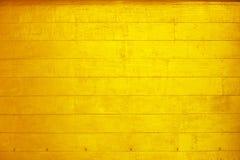 Guld- bakgrund för målarfärgträvägg för design royaltyfria bilder