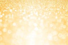 Guld- bakgrund för födelsedagparti Arkivfoton