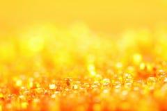 Guld- bakgrund för gult sken Fotografering för Bildbyråer