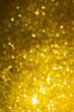 Guld- bakgrund, lyckligt nytt år för abstrakt guld- bokehljus Arkivbilder