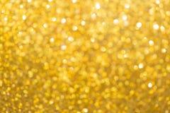 Guld- bakgrund, lyckligt nytt år för abstrakt guld- bokehljus arkivfoton