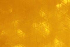 Guld- bakgrund - materielfoto Arkivfoto