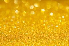 Guld- bakgrund med mousserar Fotografering för Bildbyråer