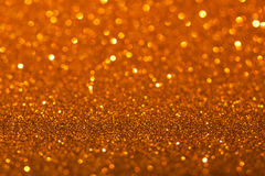 Guld- bakgrund med mousserar Arkivbilder
