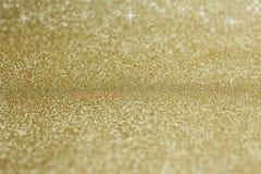 Guld- bakgrund med stjärnor Arkivfoto