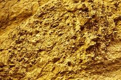 Guld- bakgrund och textur av organisk stenyttersida Fotografering för Bildbyråer