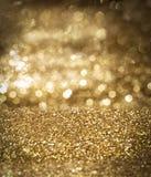 Guld- bakgrund som är guld- blänker, jul Arkivfoton