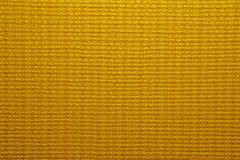 Guld- bakgrund texturerar Royaltyfria Bilder