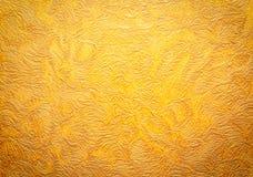 Guld- bakgrund texturerar wallpaper för bakgrundsstånghorisontallövrik paper vägg Royaltyfria Bilder