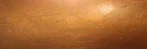 Guld- bakgrunds- eller textur- och lutningskugga Skinande gul bakgrund för textur för guld- folie för blad Guld- bakgrundspapper, Arkivfoto