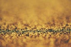 guld- bakgrundsbokeh fotografering för bildbyråer