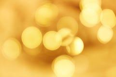 guld- bakgrundsbokeh Arkivbild