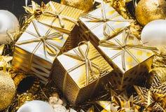 guld- bakgrundsjul Arkivbild