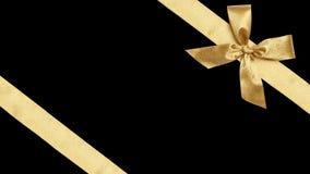 Guld- band för gåvasjal för jul som isoleras Royaltyfria Foton