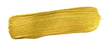 Guld- baner för färgmålarfärgborste För suddslaglängd för akryl guld- fläck på vit bakgrund Detaljerad guld för skenabstrakt begr Royaltyfri Foto