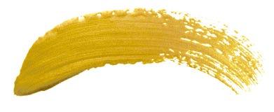 Guld- baner för färgmålarfärgborste För suddslaglängd för akryl guld- fläck på vit bakgrund Detaljerad guld för skenabstrakt begr Royaltyfri Fotografi