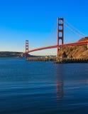 guld- bara soluppgång för broport Arkivbilder
