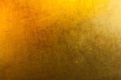 Guld- begrepp för texturtapetbakgrund arkivbilder