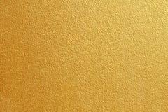 Guld- betongvägg på bakgrundstextur royaltyfri foto