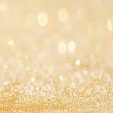 Guld- blänka abstrakt bakgrund för jul med bokehdefocuse Fotografering för Bildbyråer
