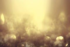 Guld- blänka abstrakt bakgrund för jul med defocused sp Fotografering för Bildbyråer