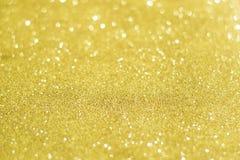 Guld- blänka bakgrund för jul Tex för ferieguldabstrakt begrepp Arkivfoto