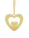 Guld- blänka hjärta, som julgarnering på band isolerade Arkivbilder