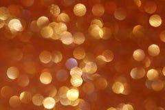 Guld- blänka julljus suddighet abstrakt bakgrund Arkivbilder