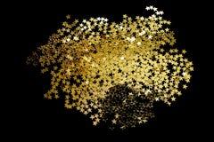 Guld- blänka på svart Royaltyfria Bilder
