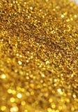 Guld blänker bakgrund Arkivbilder