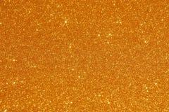 Guld blänker bakgrund - materielfoto Royaltyfria Foton