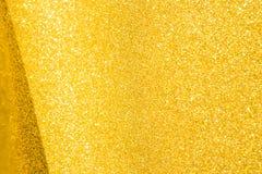 Guld blänker bakgrund, selektiv fokus Arkivfoto