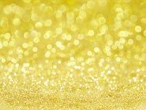 Guld blänker & bokeh royaltyfri bild