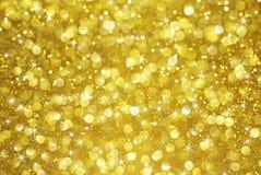 Guld blänker bokeh med stjärnabakgrund Arkivfoton