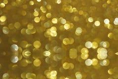 Guld blänker bokehtexturbakgrund stock illustrationer